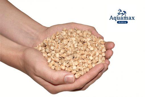 Aquamax pellets in a hand